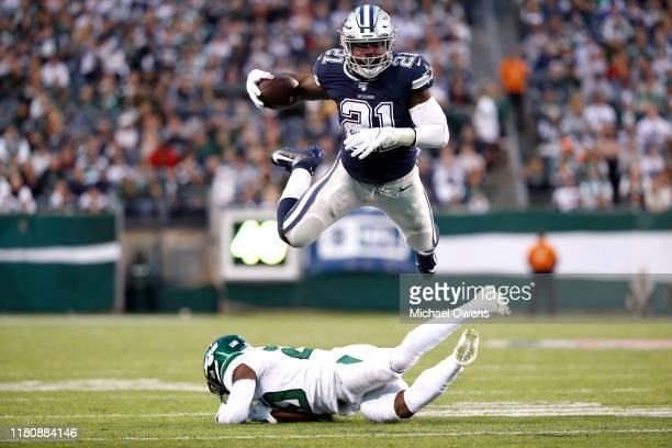 Ezekiel Elliott of the Dallas Cowboys leaps over Marcus Maye of the New York Jets in the third quarter at MetLife Stadium on October 13 2019 in East...