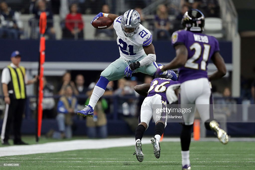 Ezekiel Elliott #21 of the Dallas Cowboys leaps over Tavon Young #36 of the Baltimore Ravens during the third quarter of their game at AT&T Stadium on November 20, 2016 in Arlington, Texas.