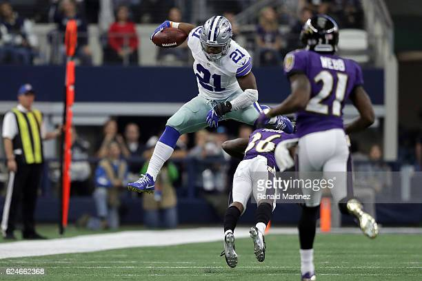 Ezekiel Elliott of the Dallas Cowboys leaps over Tavon Young of the Baltimore Ravens during the third quarter of their game at ATT Stadium on...