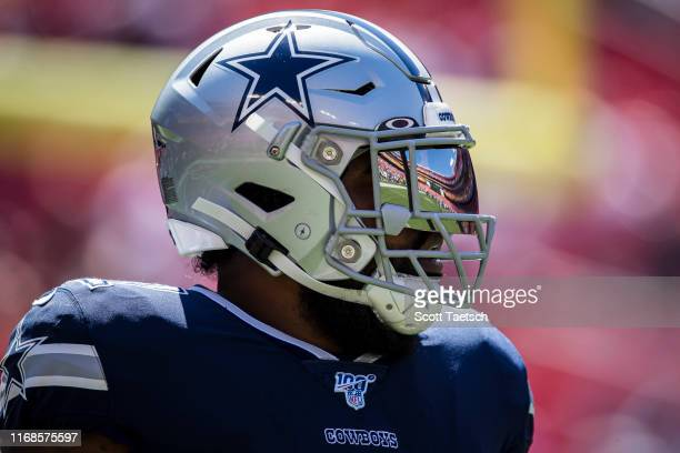 Ezekiel Elliott of the Dallas Cowboys looks on before the game against the Washington Redskins at FedExField on September 15 2019 in Landover Maryland