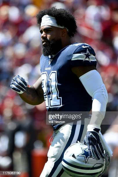 Ezekiel Elliott of the Dallas Cowboys looks on during the first half against the Washington Redskins at FedExField on September 15 2019 in Landover...