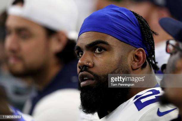 Ezekiel Elliott of the Dallas Cowboys looks on from the bench in the third quarter against the Washington Redskins in the game at ATT Stadium on...