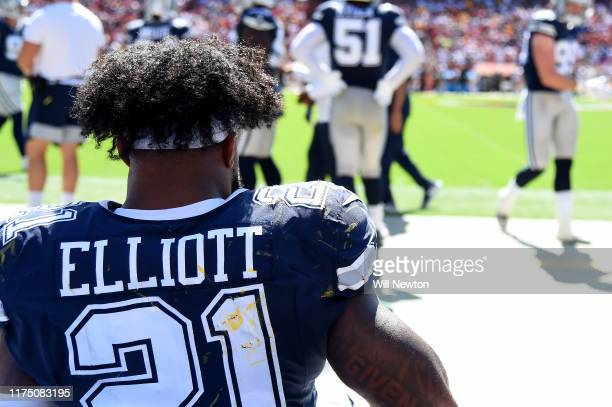 Ezekiel Elliott of the Dallas Cowboys looks on from the sideline during the first half against the Washington Redskins at FedExField on September 15...