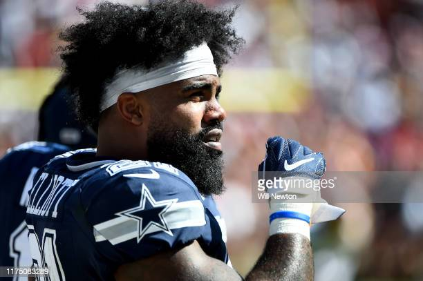 Ezekiel Elliott of the Dallas Cowboys looks on from the sideline during the second half against the Washington Redskins at FedExField on September 15...
