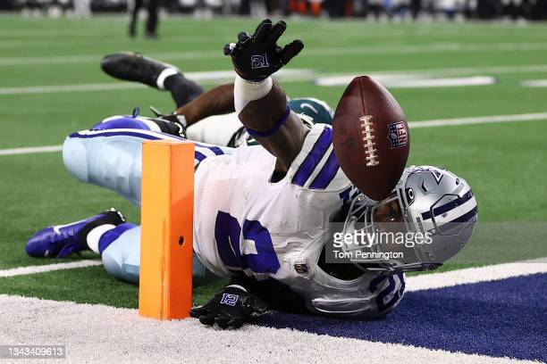 Ezekiel Elliott of the Dallas Cowboys loses the ball trying to reach for the end zone during a first half run in front of Darius Slay of the...
