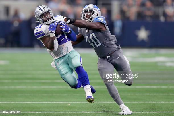 Ezekiel Elliott of the Dallas Cowboys pulls in a pass against Jarrad Davis of the Detroit Lions in the fourth quarter at AT&T Stadium on September...