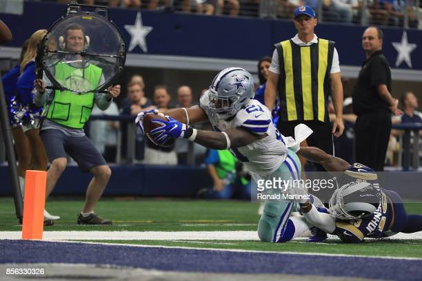 Ezekiel Elliott of the Dallas Cowboys reaches for the goal line but was down just short on the tackle by John Johnson of the Los Angeles Rams in the...