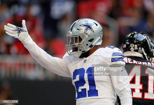 Ezekiel Elliott of the Dallas Cowboys reacts after rushing for a first down against the Atlanta Falcons at MercedesBenz Stadium on November 18 2018...