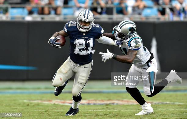 Ezekiel Elliott of the Dallas Cowboys runs the ball against Da'Norris Searcy of the Carolina Panthers in the third quarter during their game at Bank...