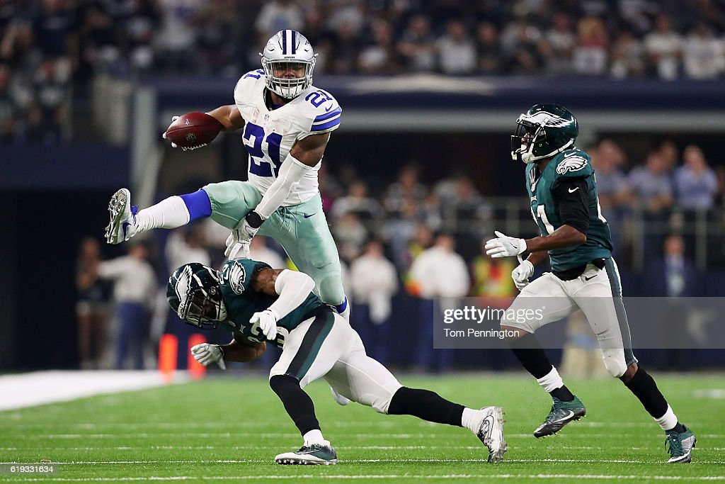 Ezekiel Elliott #21 of the Dallas Cowboys runs the ball against Rodney McLeod #23 of the Philadelphia Eagles in the second quarter during a game between the Dallas Cowboys and the Philadelphia Eagles at AT&T Stadium on October 30, 2016 in Arlington, Texas.