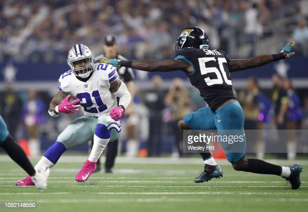 Ezekiel Elliott of the Dallas Cowboys runs the ball against Telvin Smith of the Jacksonville Jaguars in the third quarter of a game at ATT Stadium on...