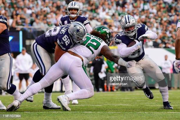Ezekiel Elliott of the Dallas Cowboys runs the ball against the New York Jets at MetLife Stadium on October 13 2019 in East Rutherford New Jersey