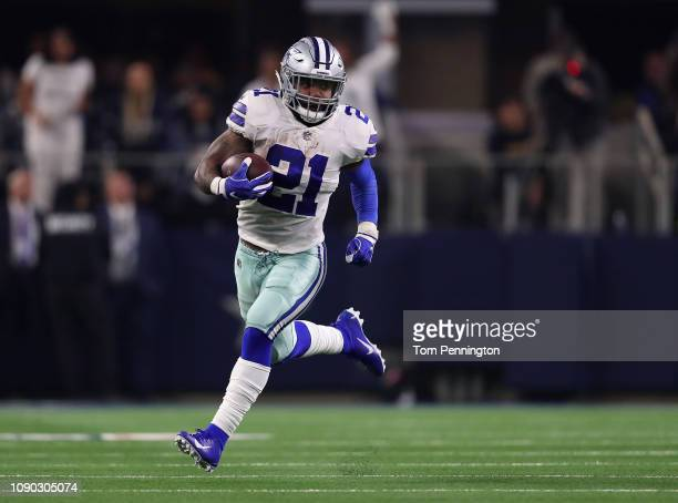 Ezekiel Elliott of the Dallas Cowboys runs the ball in the second quarter against the Seattle Seahawks during the Wild Card Round at ATT Stadium on...