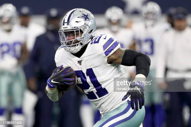 Ezekiel Elliott of the Dallas Cowboys runs with the ball in the first quarter against the Washington Redskins in the game at ATT Stadium on December...