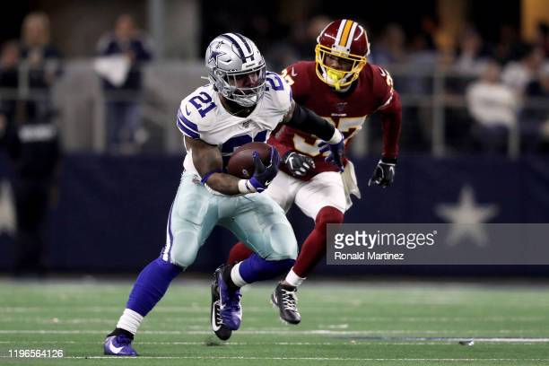 Ezekiel Elliott of the Dallas Cowboys runs with the ball in the third quarter against the Washington Redskins in the game at ATT Stadium on December...