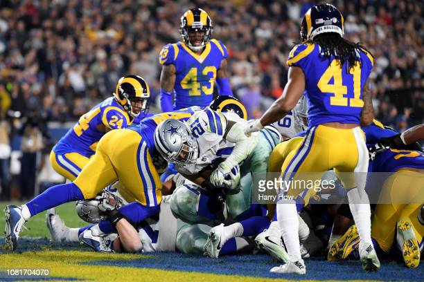 Ezekiel Elliott of the Dallas Cowboys scores a 1 yard touchdown in the third quarter against the Los Angeles Rams in the NFC Divisional Playoff game...