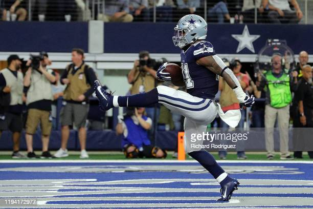 Ezekiel Elliott of the Dallas Cowboys struts into the end zone for a touchdown in the second quarter against the Los Angeles Rams at ATT Stadium on...