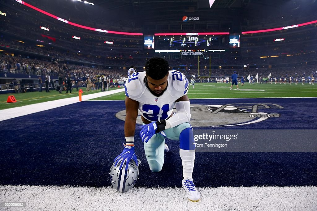 Ezekiel Elliott #21 of the Dallas Cowboys takes a knee in the end zone before the Cowboys play the Detroit Lions at AT&T Stadium on December 26, 2016 in Arlington, Texas.
