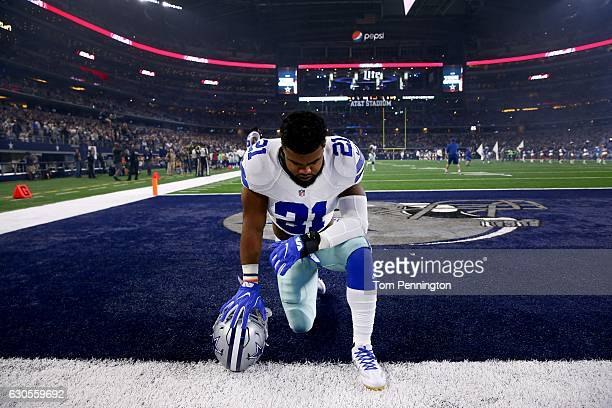 Ezekiel Elliott of the Dallas Cowboys takes a knee in the end zone before the Cowboys play the Detroit Lions at ATT Stadium on December 26 2016 in...