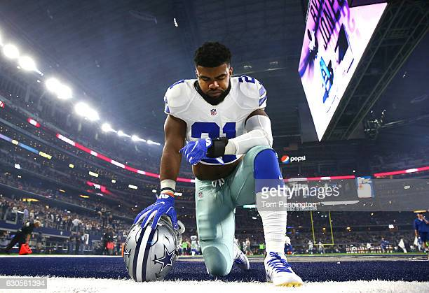 Ezekiel Elliott of the Dallas Cowboys takes a knee in the end zone before the Cowboys played the Detroit Lions at ATT Stadium on December 26 2016 in...