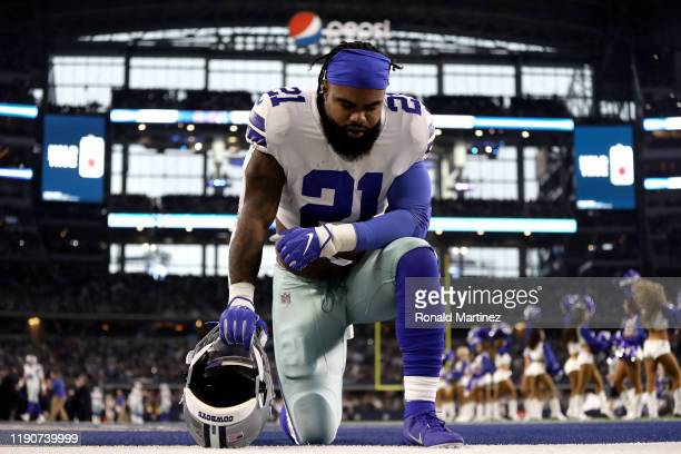 Ezekiel Elliott of the Dallas Cowboys takes a knee in the endzone before a game against the Buffalo Bills at ATT Stadium on November 28 2019 in...