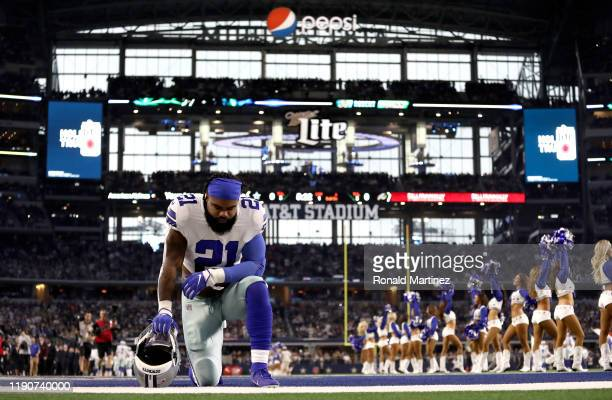 Ezekiel Elliott of the Dallas Cowboys takes a knee in the endzone before a game against the Buffalo Bills at AT&T Stadium on November 28, 2019 in...