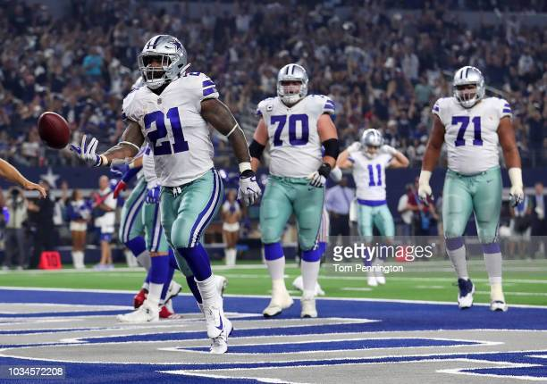 Ezekiel Elliott of the Dallas Cowboys tosses the football after a fourth quarter touchdown against the New York Giants at ATT Stadium on September 16...