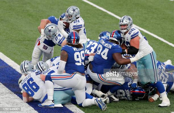 Ezekiel Elliott of the Dallas Cowboys touchdown against the New York Giants at MetLife Stadium on January 03, 2021 in East Rutherford, New Jersey....