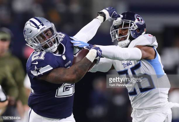 Ezekiel Elliott of the Dallas Cowboys tries to hold off Logan Ryan of the Tennessee Titans on a run in the first quarter of a game at ATT Stadium on...