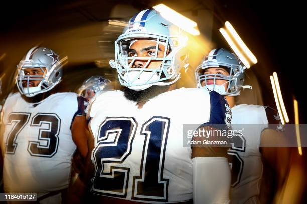 Ezekiel Elliott of the Dallas Cowboys walks through the tunnel before a game against the New England Patriots at Gillette Stadium on November 24 2019...