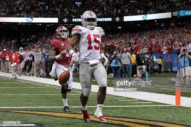 Ezekiel Elliott of the Ohio State Buckeyes celebrates after scoring a touchdown in the fourth quarter against the Alabama Crimson Tide during the All...