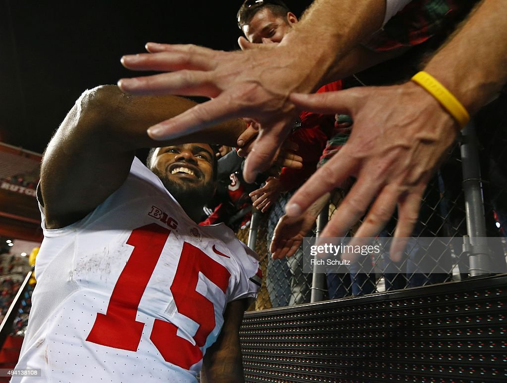 Ezekiel Elliott #15 of the Ohio State Buckeyes high fives fans after defeating the Rutgers Scarlet Knights 49-7 at High Point Solutions Stadium on October 24, 2015 in Piscataway, New Jersey.