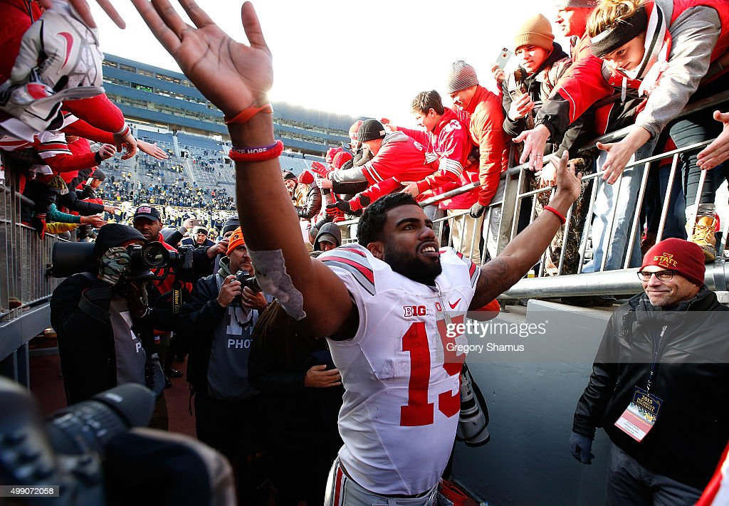 Ezekiel Elliott #15 of the Ohio State Buckeyes leaves the field after a 42-13 win over the Michigan Wolverines at Michigan Stadium on November 28, 2015 in Ann Arbor, Michigan.