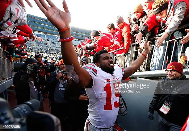 Ezekiel Elliott of the Ohio State Buckeyes leaves the field after a 4213 win over the Michigan Wolverines at Michigan Stadium on November 28 2015 in...