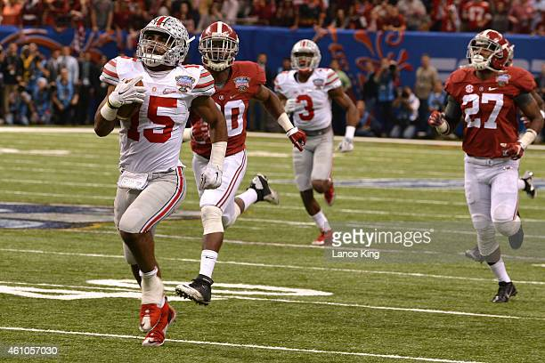 Ezekiel Elliott of the Ohio State Buckeyes runs for an 85yard touchdown against the Alabama Crimson Tide during the Allstate Sugar Bowl at the...