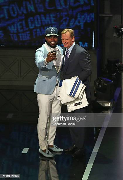 Ezekiel Elliott takes a 'selfie' with Roger Goddell during the 2016 NFL Draft at the Auditorium Theater on April 28 2016 in Chicago Illinois