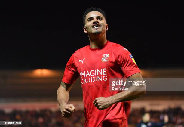 Ezekiel Fryers of Swindon Town celebrates after his team mate Eóin Doyle of Swindon Town scores his side's second goal during the Sky Bet League Two...