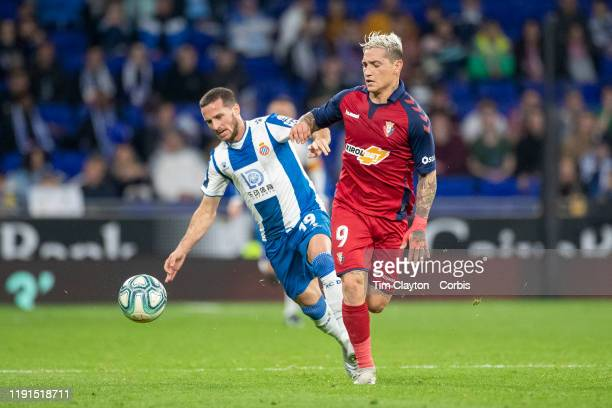 Ezequiel Avila of Osasuna challenged by Pablo Piatti of Espanyol during the Espanyol V Osasuna La Liga regular season match at RCDE Stadium on...