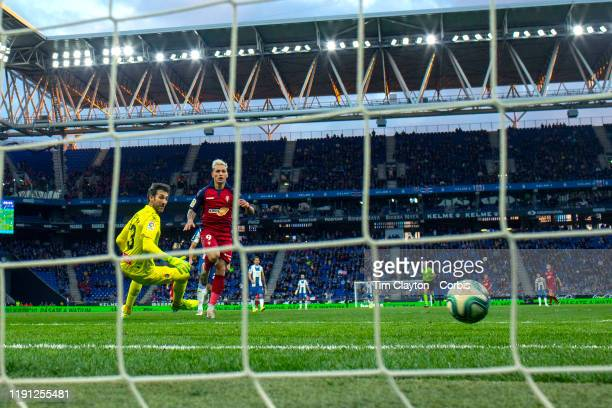 Ezequiel Avila of Osasuna scores his sides second goal beating goalkeeper Diego Lopez of Espanyol during the Espanyol V Osasuna La Liga regular...