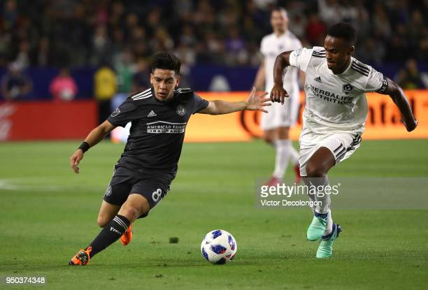 Ezequiel Barco of Atlanta United and Ola Kamara of Los Angeles Galaxy vie for the ball during the first half of the MLS match at StubHub Center on...