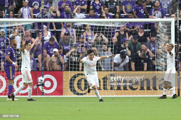 Ezequiel Barco of Atlanta United FC celebrates a goal with Josef Martinez and Miguel Almiron of Atlanta United FC during a MLS soccer match against...