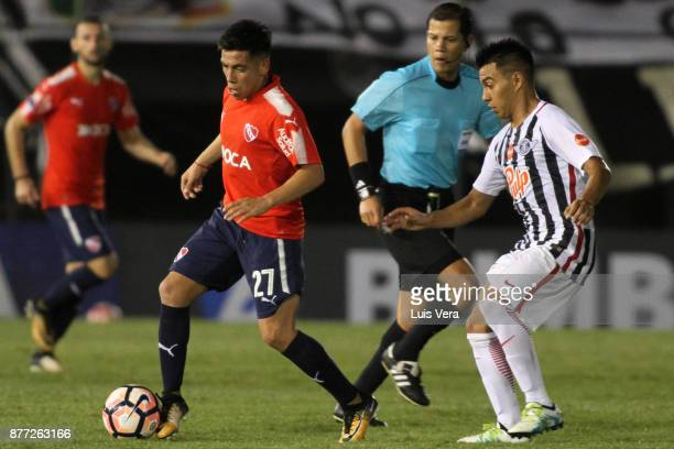 Ezequiel Barco of Independiente fights for the ball with Jesus Medina of Libertad during a first leg match between Libertad and Independiente as part...