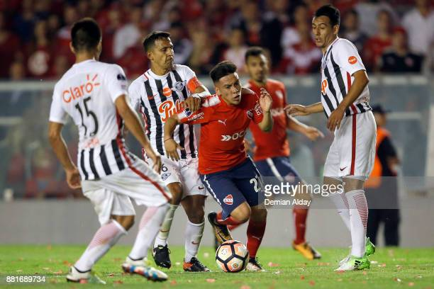 Ezequiel Barco of Independiente fights for the ball with Sergio Aquino of Libertad during a second leg match between Independiente and Libertad as...