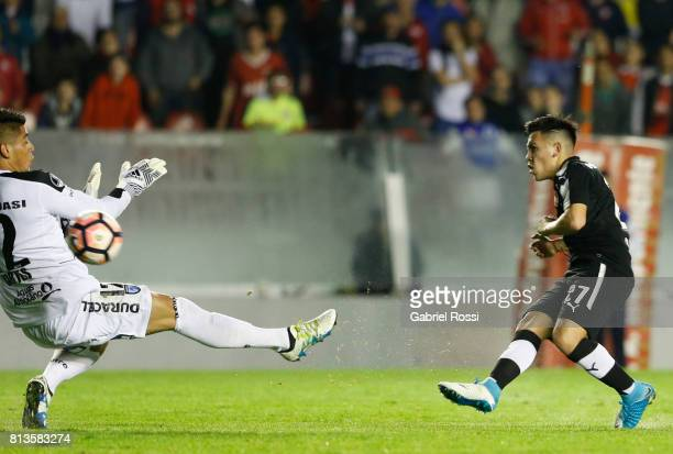 Ezequiel Barco of Independiente kicks the ball to score the second goal of his team during the first leg match between Independiente and Deportes...