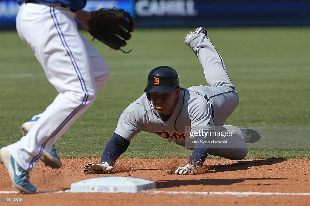 Ezequiel Carrera #61 of the Detroit Tigers steals third base in the tenth inning during MLB game action against the Toronto Blue Jays on August 9, 2014 at Rogers Centre in Toronto, Ontario, Canada.