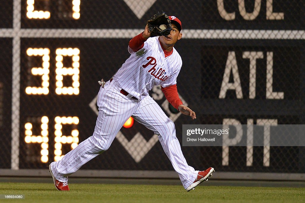 Ezequiel Carrera #16 of the Philadelphia Phillies catches a fly ball in the ninth inning against the St. Louis Cardinals at Citizens Bank Park on April 18, 2013 in Philadelphia, Pennsylvania. The Cardinals won 4-3.