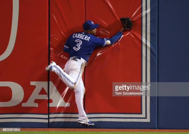 Ezequiel Carrera of the Toronto Blue Jays cannot catch a double hit by Nelson Cruz of the Seattle Mariners in the eighth inning during MLB game...