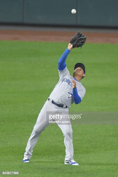 Ezequiel Carrera of the Toronto Blue Jays catches a fly ball during a baseball game against the Baltimore Orioles at Oriole Park at Camden Yards on...