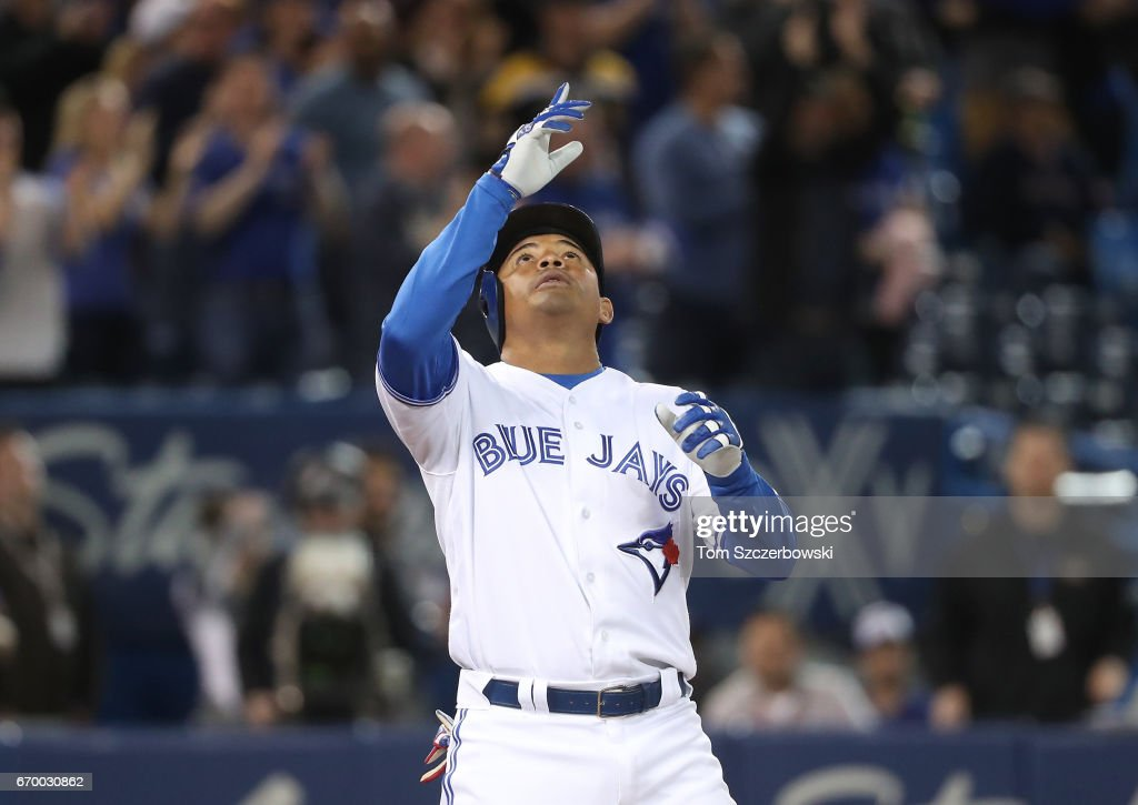 Ezequiel Carrera #3 of the Toronto Blue Jays celebrates after hitting a two-run home run in the ninth inning during MLB game action against the Boston Red Sox at Rogers Centre on April 18, 2017 in Toronto, Canada.
