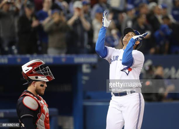 Ezequiel Carrera of the Toronto Blue Jays celebrates after hitting a tworun home run in the fourth inning during MLB game action as Roberto Perez of...